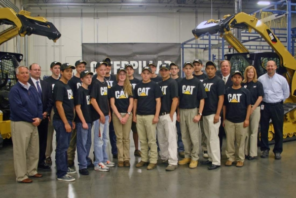 Team members posing for a photograph at Caterpillar's Sanford Facility.