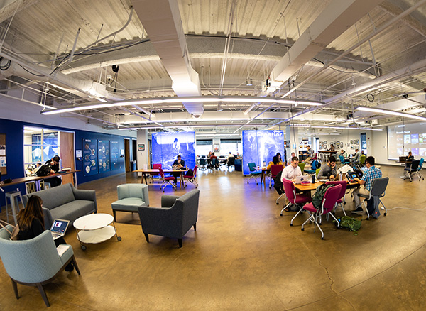 Main coworking space at Frontier RTP. A wide open space with various tables and chairs and other amenities.