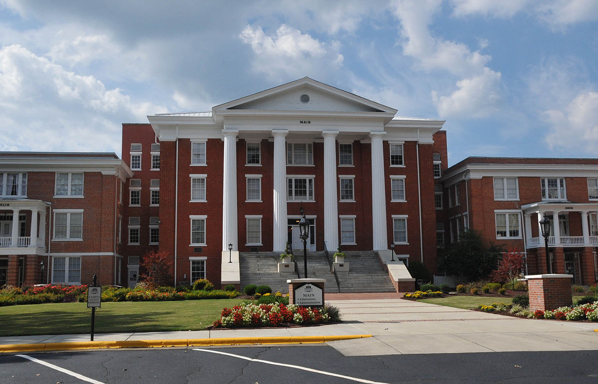 Main building of Louisburg College. The front of the building is lined with classic, tall columns.