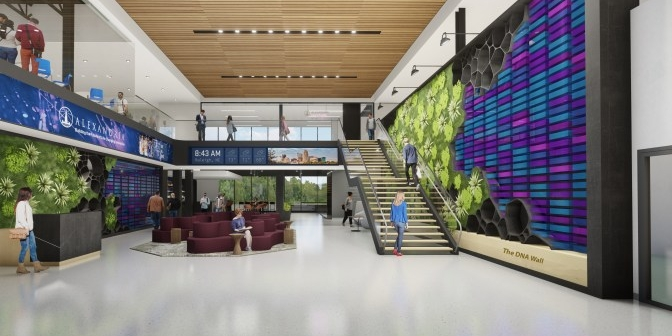 Wide open lobby at Alexandria Center for AgTech. A standout feature is the DNA wall lining the lobby, containing colored sequences and patterns.