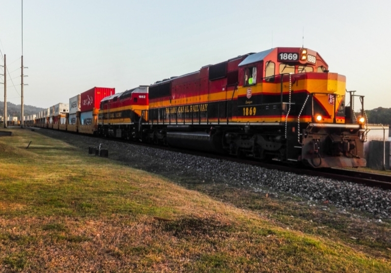 Freight train chugging along on a sunny afternoon.